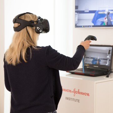 A woman engaging in a virtual reality medical training at the Johnson & Johnson Institute