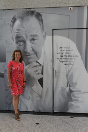 Hanneke Schuitemaker in Front of a Photo of Physician Paul Janssen, Founder of Janssen Pharmaceuticals, at Her Office in the Netherlands