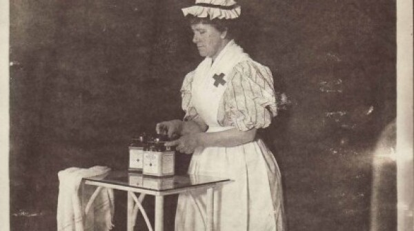 A photo of a woman packing sterile gauze into hermetically sealable jars