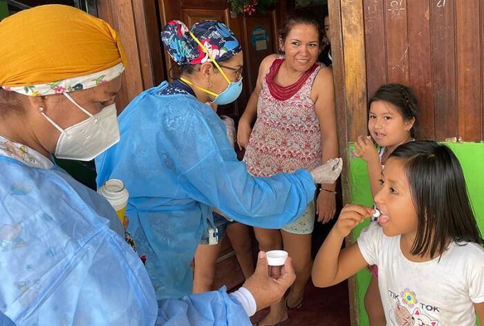 Community healthcare workers in Peru deliver Johnson & Johnson medicine