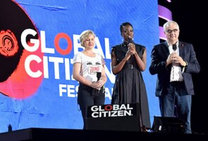 Paul Stoffels, Johnson & Johnson's Chief Scientific Officer, on stage at the 2018 Global Citizen Festival with researcher Glenda Gray and actress Danai Gurira