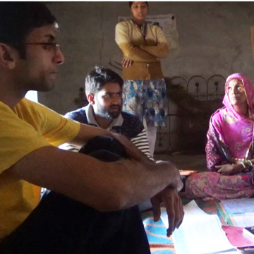 Ruchit Nagar meets with local mothers to demonstrate how the necklace works