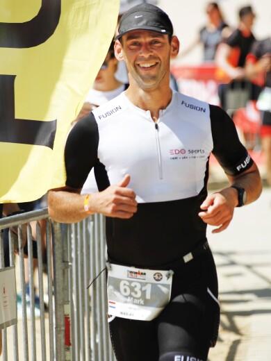 Mark van Ooij competing in a triathlon