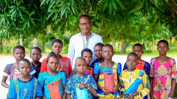 Philemon Padonou with CodeToHope children