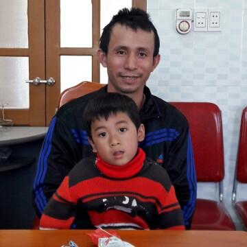 Tuberculosis survivors Le Van Giang and his son Le Nguyen Van An