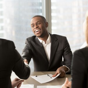 Man shaking hands with employer at a job interview
