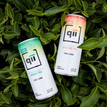 Two cans of qii tea