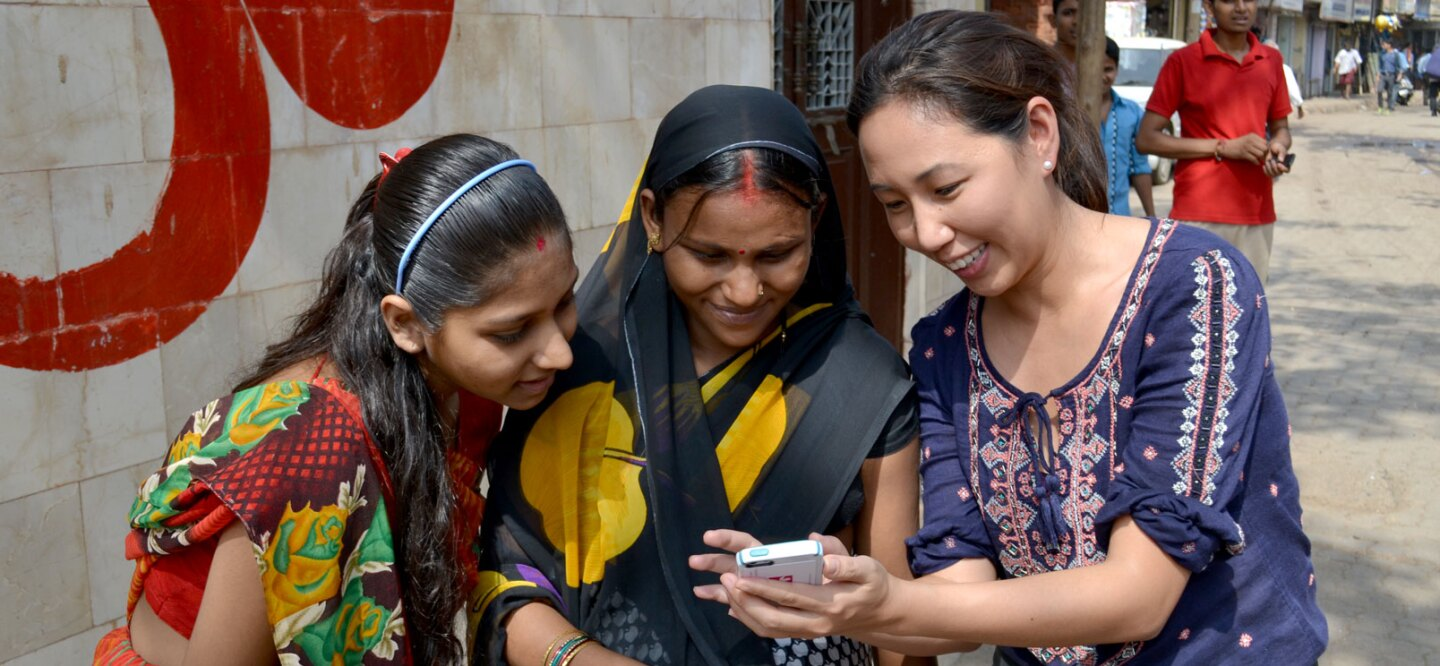 Alice Lin Fabiano shows women in India how mMitra works