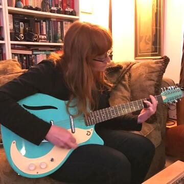 Margaret Gurowitz plays guitar
