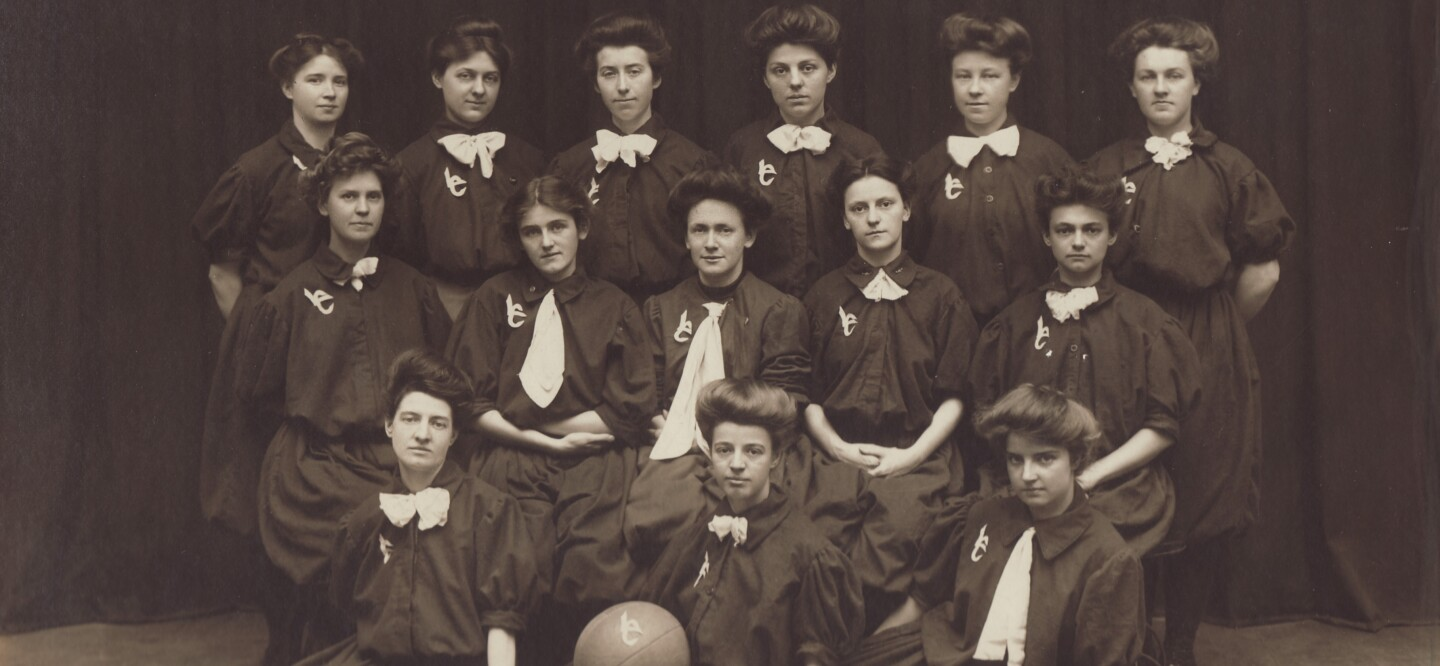 The women of the Laurel Club pose for a team photo as Johnson & Johnson's first women's basketball team