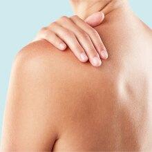 A photo of a woman's bare left shoulder