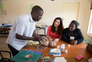 A photo of Joy Marini with two trainers in the Helping Babies Breathe program in Malawi