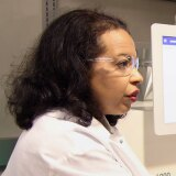 Esi Lamousé-Smith in the lab with colleagues reviewing microbial data