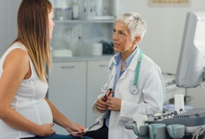 A pregnant woman consulting with her physician