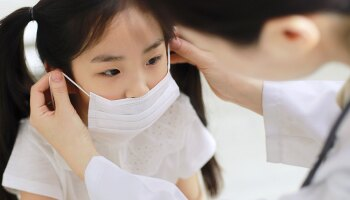A girl wearing a surgical mask