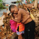 Two children hugging after Hurricane Maria