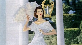 Woman in white dress modeling for Modess sanitary napkins