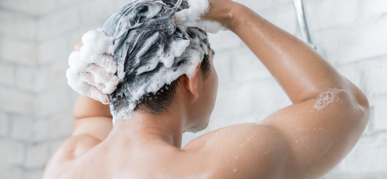 Man shampooing his hair
