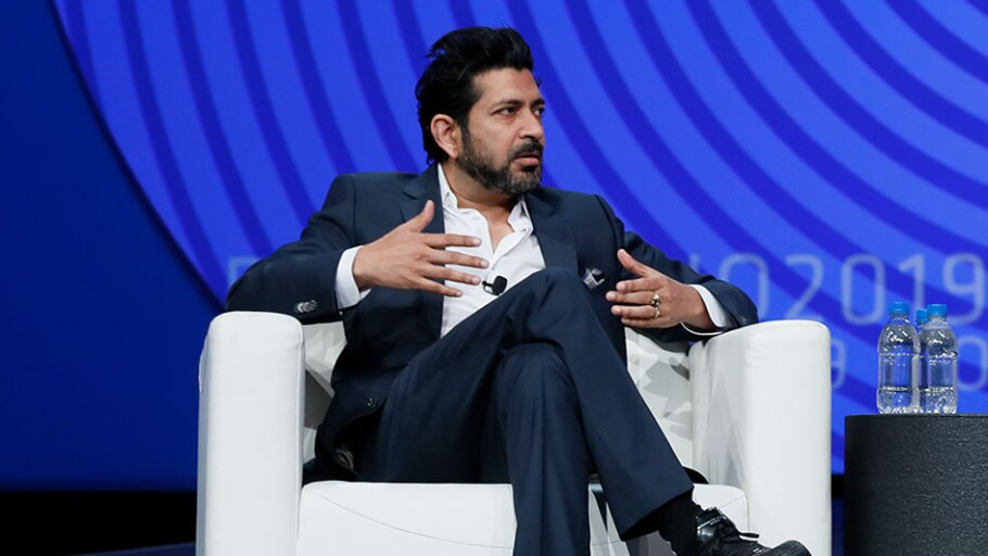 Siddhartha Mukherjee, M.D., (left) delivering a keynote at the 2019 BIO International Convention