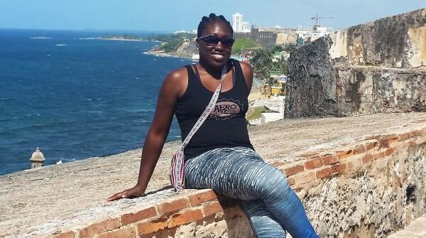 Imade Nibokun Borha sitting outside