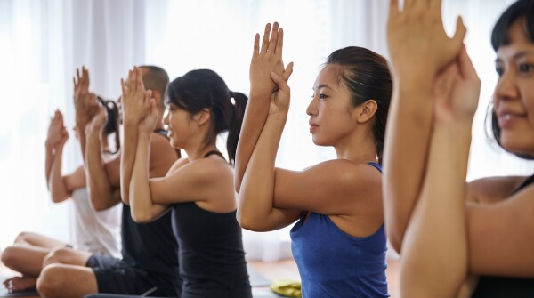 A photo of people practicing yoga