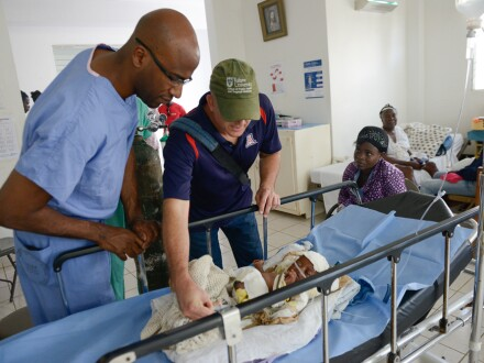 Pierre Theodore, M.D., volunteering at a hospital in Haiti