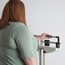 A photo of a women at a mechanical scale