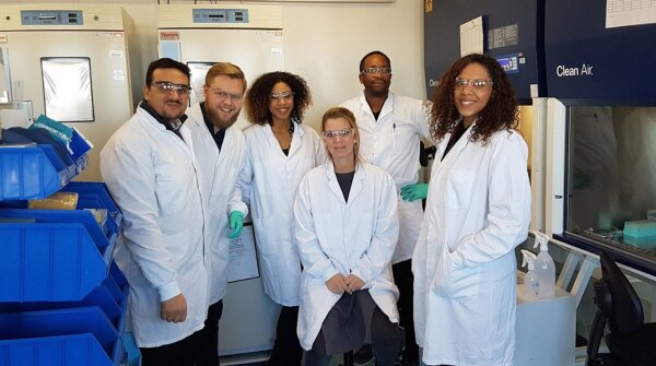 A photo of Abdullah Al Hommada with colleagues in Janssen's clinical immunology lab