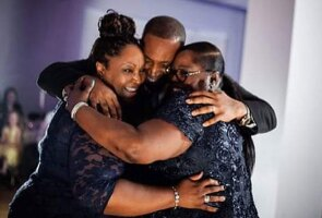 Valarie Tucker hugging her family members