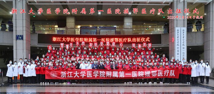Doctors in China posing in front of the First Affiliated Hospital, Medical College of Zhejiang University in Hangzhou, Zhejiang Province