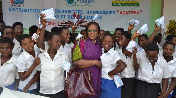 A photo of Francoise Nibizi distributing Agateka pads to students