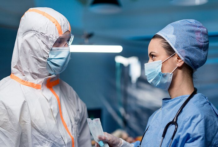 Healthcare providers wearing personal protective equipment