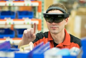 An employee using augmented reality for supply chain optimization