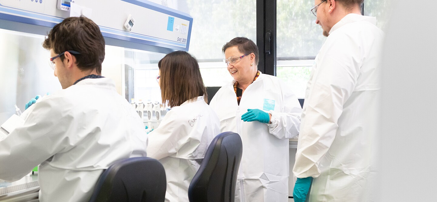 Dr. Heather Davis with her colleagues in a research laboratory