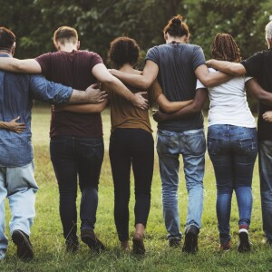 line of people with arms around each others' backs