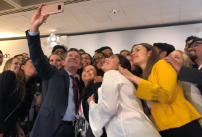 Johnson & Johnson Chairman and CEO Alex Gorsky posing for a selfie with employees