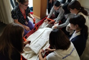 Tomodachi J&J Disaster Nursing Training Program students learning to transport injured patients at Children's National Health System