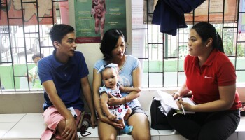 Annah Margarita Montesa meeting with a family in the Philippines