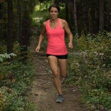 A photo of Megan Starshak running on trail