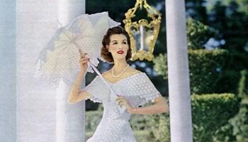 Woman in white dress modeling for Modess sanitary napkins