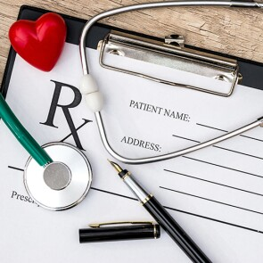 Prescription pad and stethoscope on a clipboard