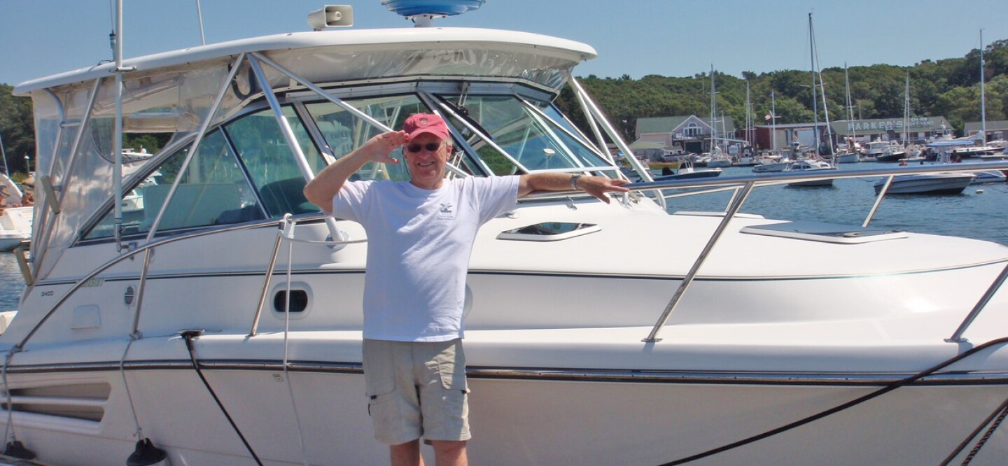 Ron Scolamiero standing in front of a boat
