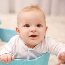 A photo of a baby in a blue box