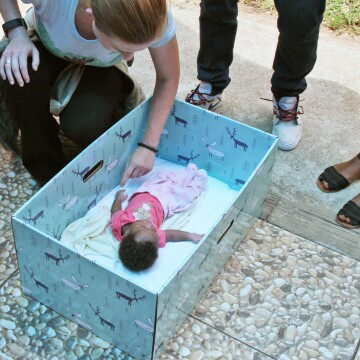 Jennifer Clary, co-founder of The Baby Box Co., with an infant at the Marigot distribution event