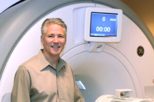 Wayne Drevets, M.D., with an MRI scanner used when researching mood disorders