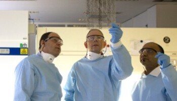 A photo of three scientists in a lab