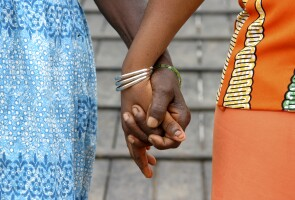 Close-up of two girls holding hands