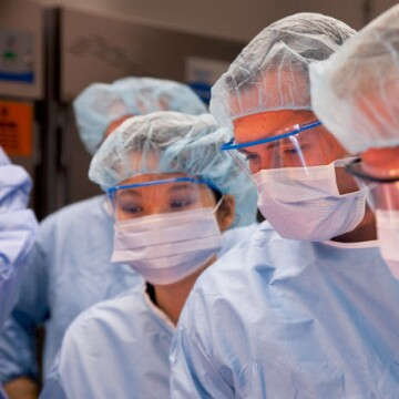 Doctors wearing masks and eye shields