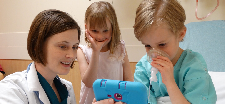 Abby Winterberg Hess demos her innovation designed to help calm children prior to surgery