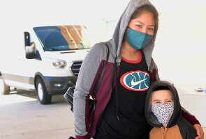 A mother and her son wearing masks